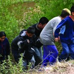 a family crossing into Mexico from Guatemala