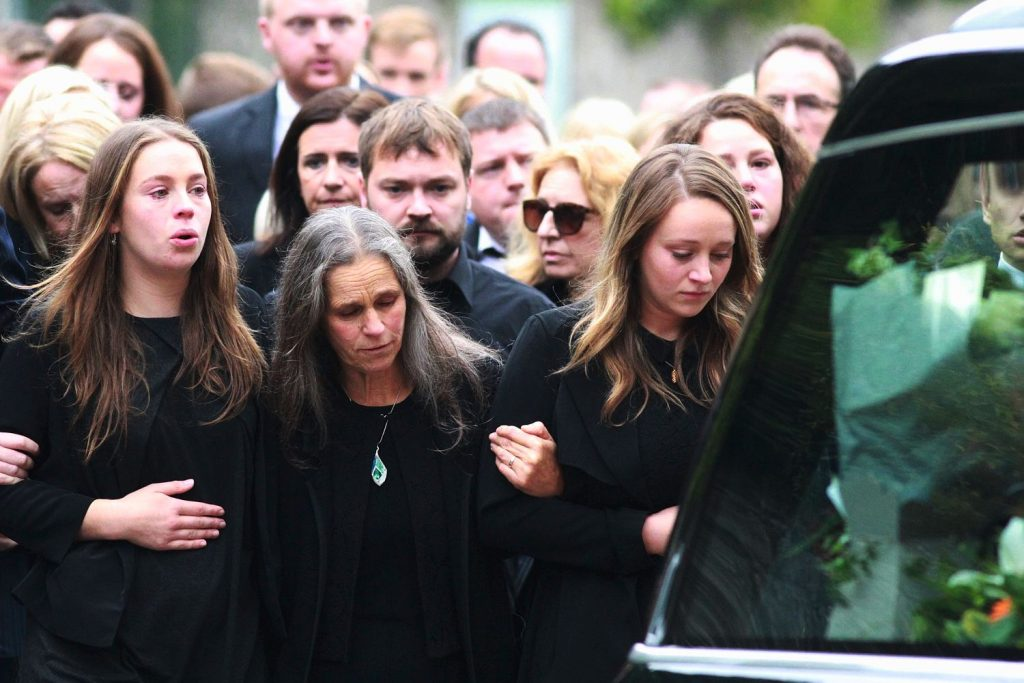 Mourners follow Michael McCoy's family to St. Maelruain's Church of Ireland in Tallaght.